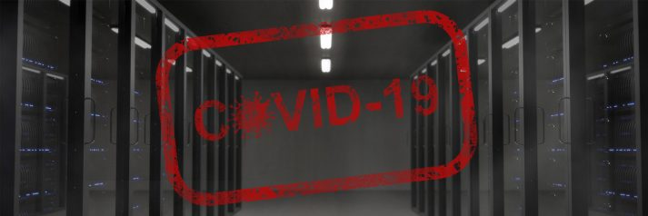 Dark server room with red covid-19 badge