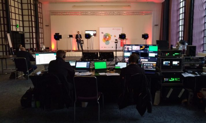Image of stage and technicians at the Univention Summit 2021